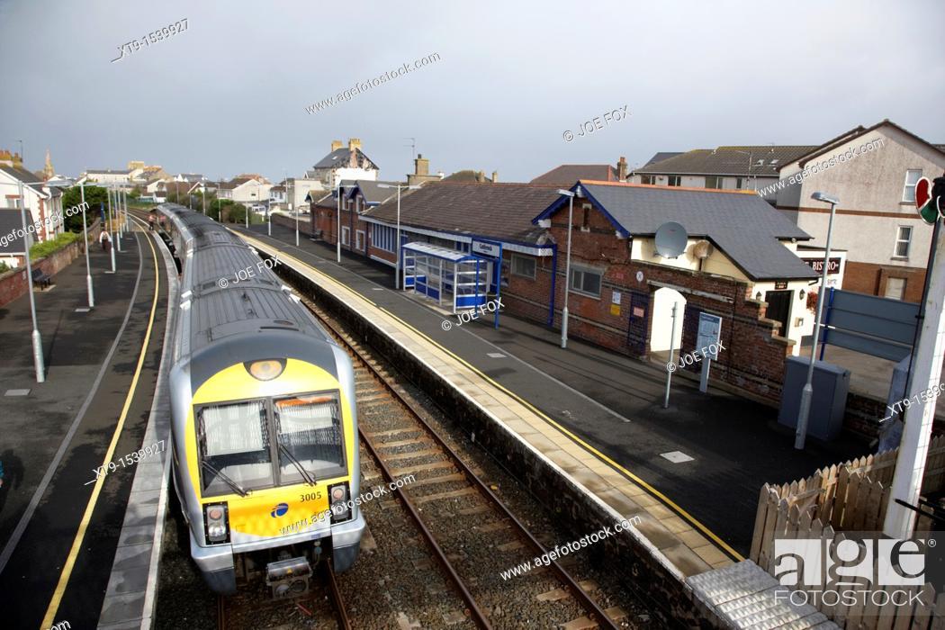 Stock Photo: northern ireland railways passenger train at castlerock railway station northern ireland uk.