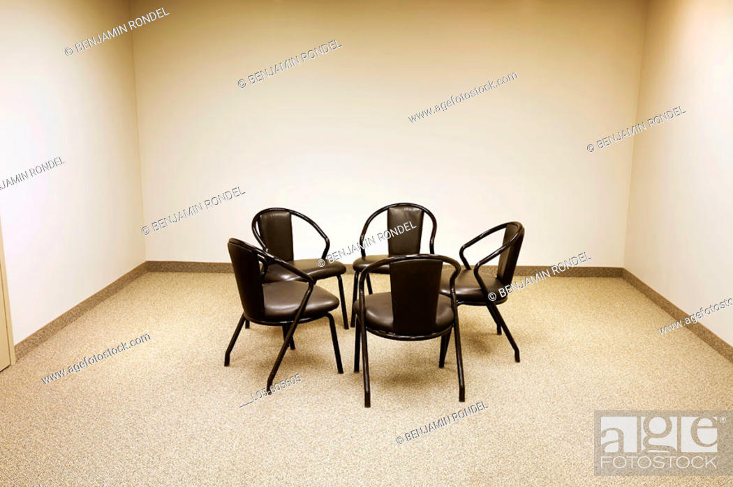 Stock Photo: Chairs in a circle in a meeting room.
