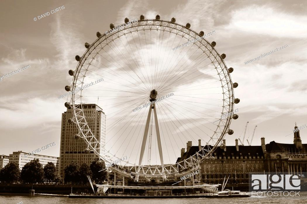Stock Photo: The millenium wheel, London eye on the River Thames in london.