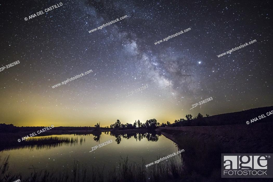 Stock Photo: Milky way over Valbona dam in summer Teruel Aragon Spain.