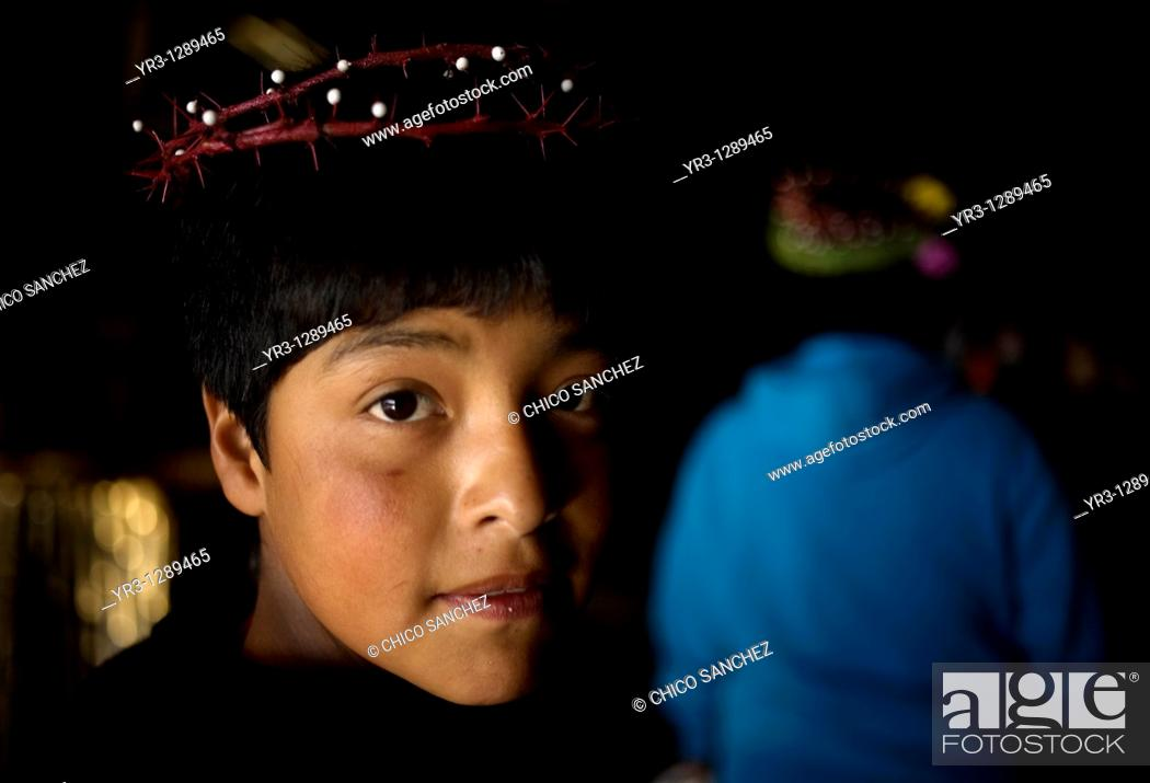 Stock Photo: A young pilgrim wearing a crown of thorns enters Our Lady of Guadalupe Basilica in Mexico City, December 8, 2010  Hundreds of thousands of Mexican pilgrims.