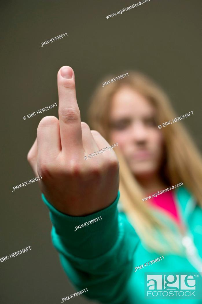 Stock Photo: Girl showing middle finger.