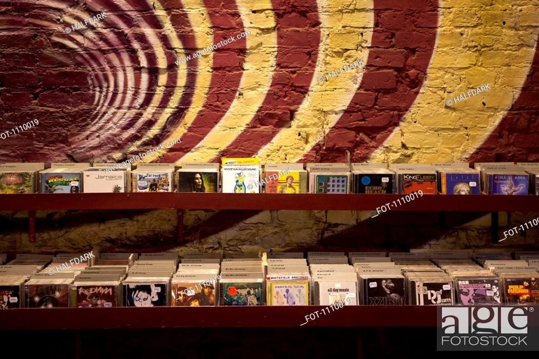 Stock Photo: Shelves of compact discs in a record shop.