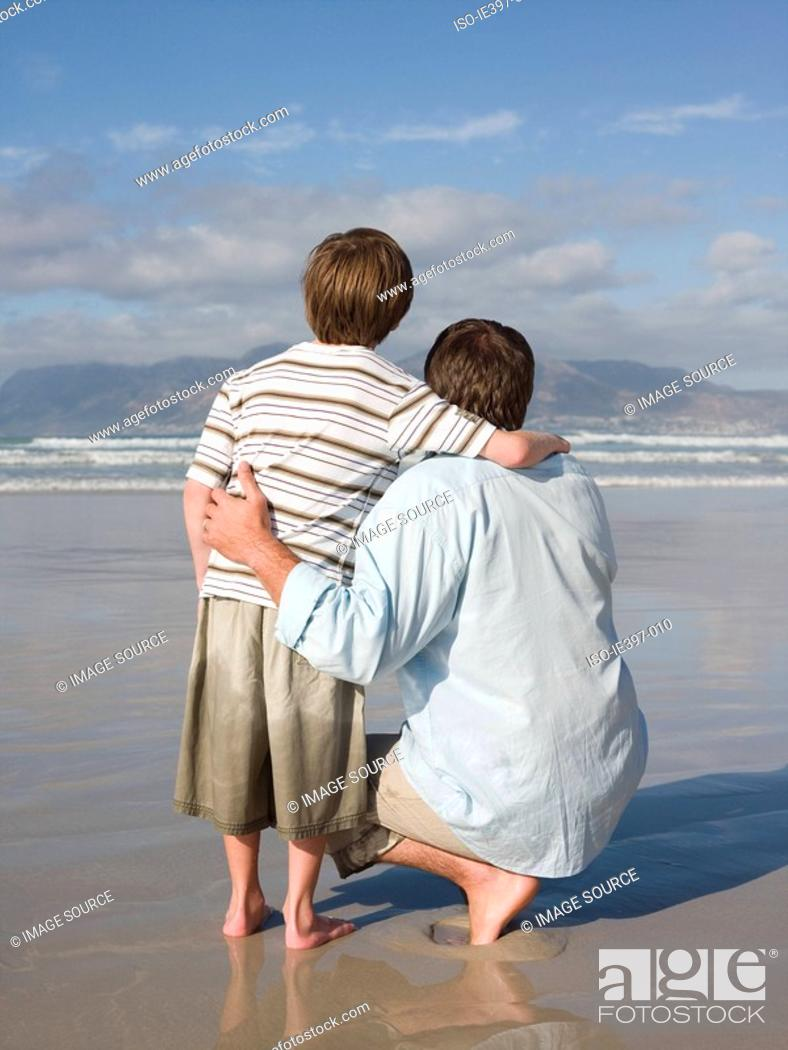 Stock Photo: Father and son by sea.