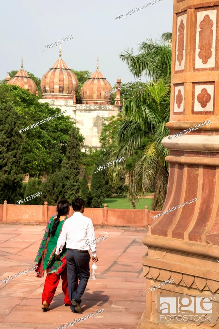 Stock Photo: Husband touching her wife's butt in Humayun's Tomb, Delhi, India.