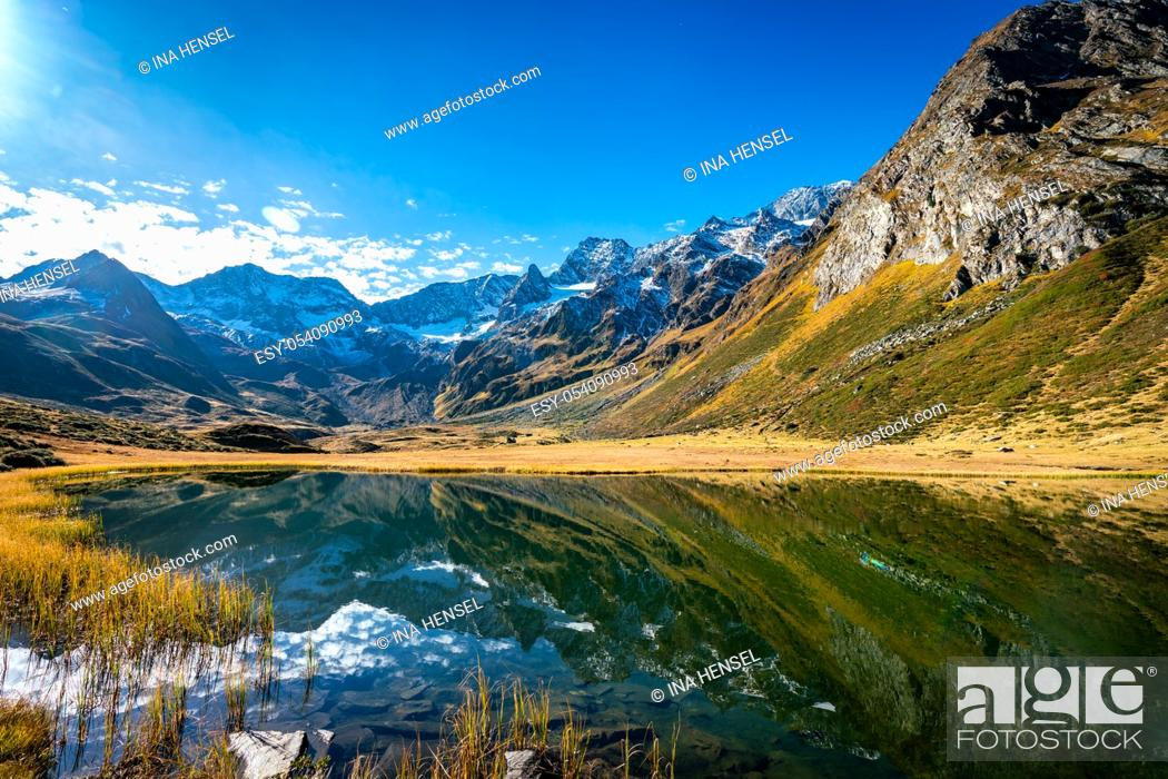 Stock Photo: Panoramic view of the alpine Seebersee lake with the high rising mountains of the Texelgruppe in the background near the Timmelsjoch alpine street in South.