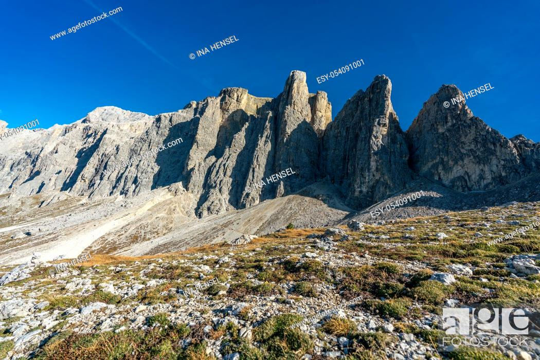 Stock Photo: Beautiful panorama view of the Sellastock massif in the italian Dolomites mountains on a very sunny autumn day with dark blue skies.
