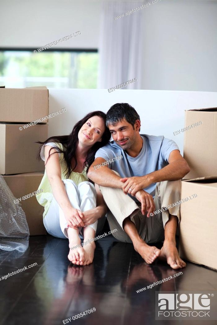 Stock Photo: Lovers sitting on the floor of their new house.