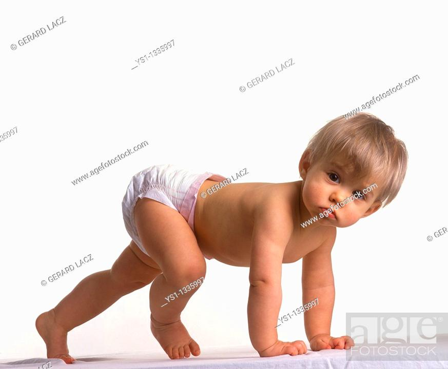 Stock Photo: Baby girl against white background.