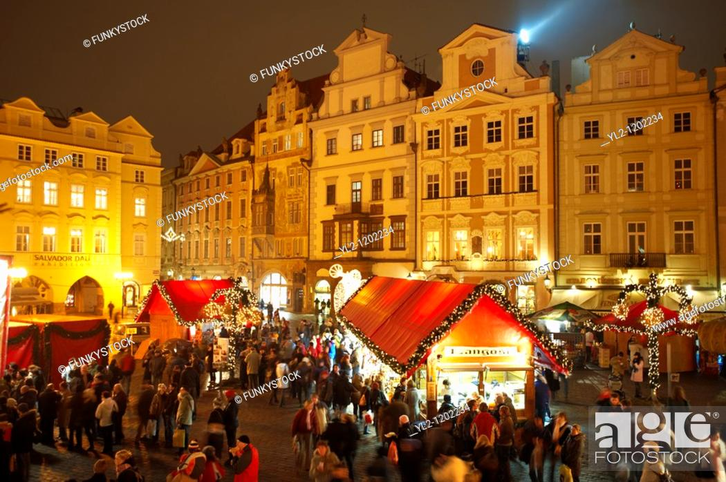 Stock Photo: Christmas Market In Prague's Old Town Square at night time.