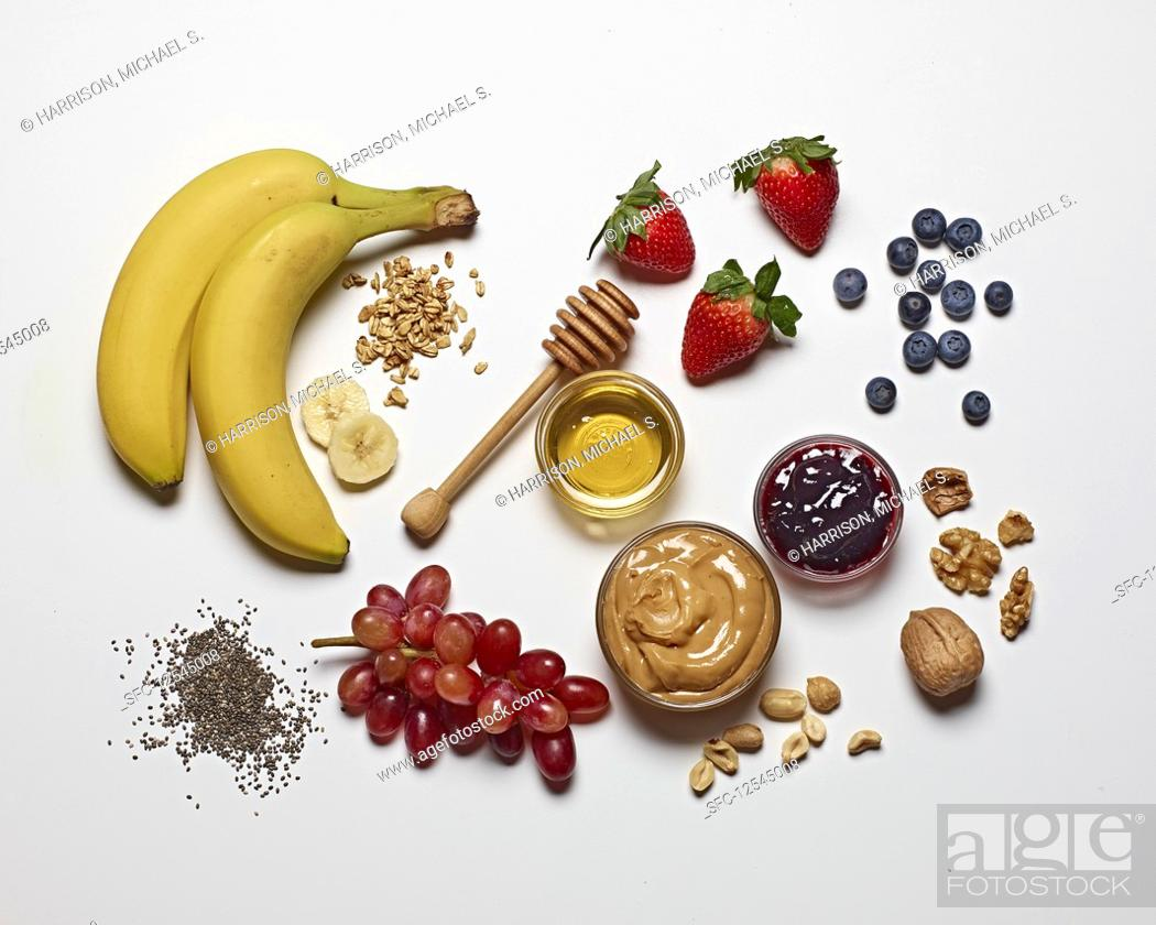 Stock Photo: Various breakfast ingredients on a white surface.