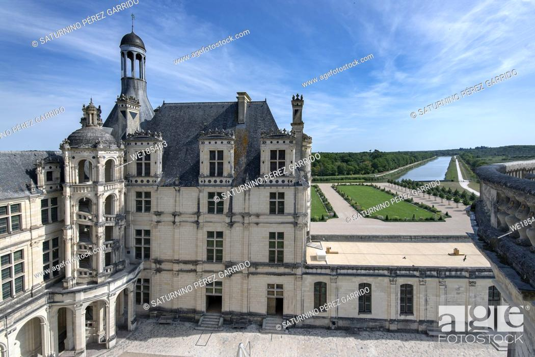 Stock Photo: Inner face of the Chambord Castle with detail of external stairs, gardens and water that goes to the moat that surrounds the castle.