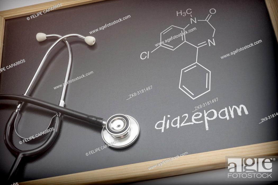 Stock Photo: Chemical formula of diazepam written with chalk on a blackboard next to a stethoscope, conceptual image.