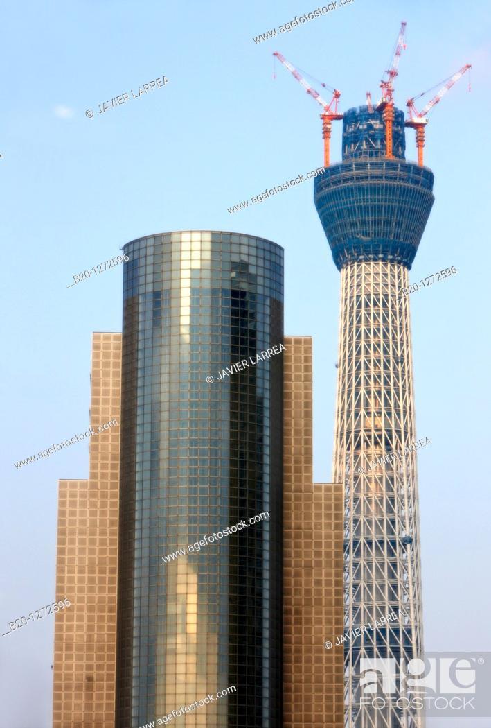 Stock Photo: Sumida City Hall and Tokyo Sky Tree under construction, Asakusa, Tokyo, Japan.