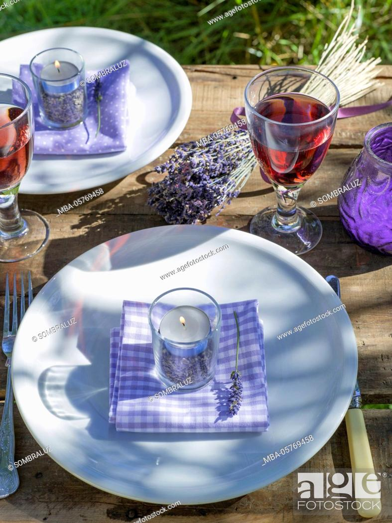 Stock Photo: Table decorations with tealights, lavender.