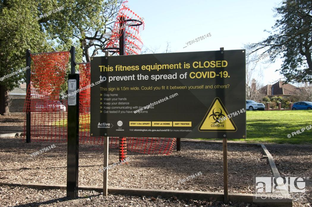 Stock Photo: Cautionary signposting in suburban parks during the COVID-19 pandemic emergency in Melbourne, Victoria, Australia.