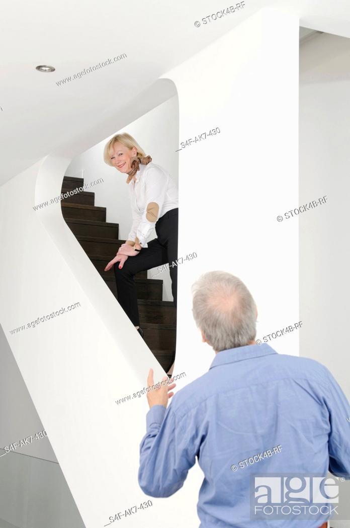 Stock Photo: Senior couple at home on staircase.