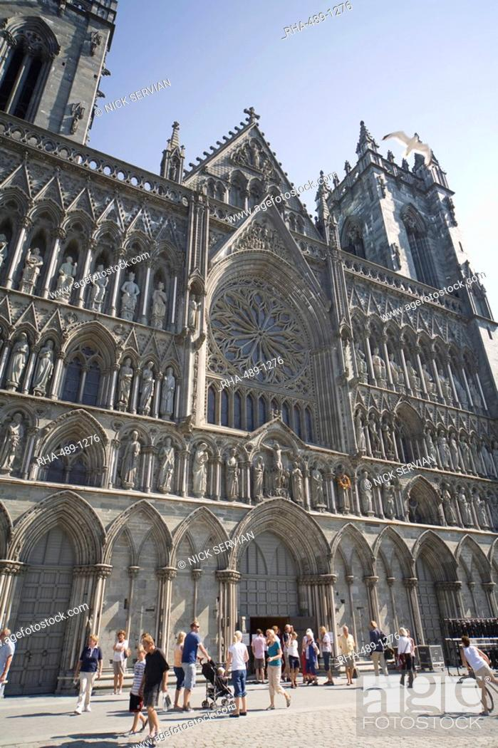 Stock Photo: Exterior of the west front, with seagull flying over, Nidaros Cathedral, Trondheim, Trondelag, Norway, Scandinavia, Europe.