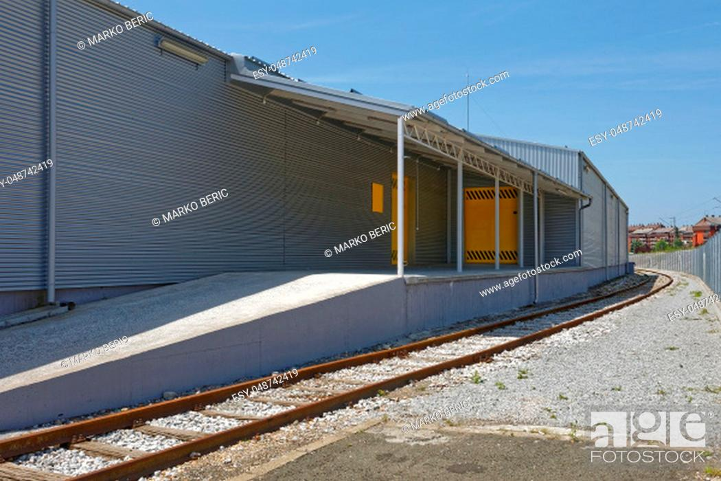 Stock Photo: Loading Dock With Railway Track at Distribution Warehouse.
