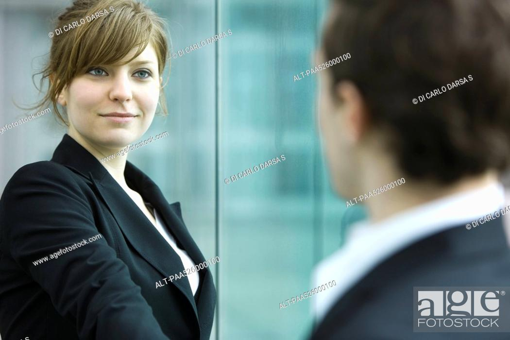 Stock Photo: Businesswoman and businessman meet and shake hands.
