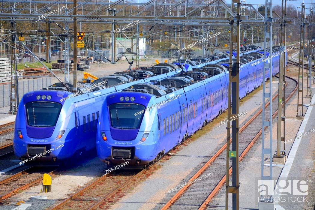 Stock Photo: Two trains on railway station in Ystad, Scania, Sweden.