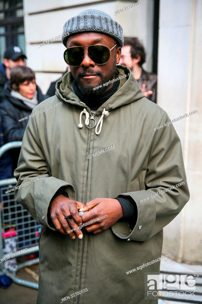 Stock Photo: Will.I.Am leaving BBC Radio Two studios after promoting his new book WaR : Wizards and Robots - London Featuring: Will.I.