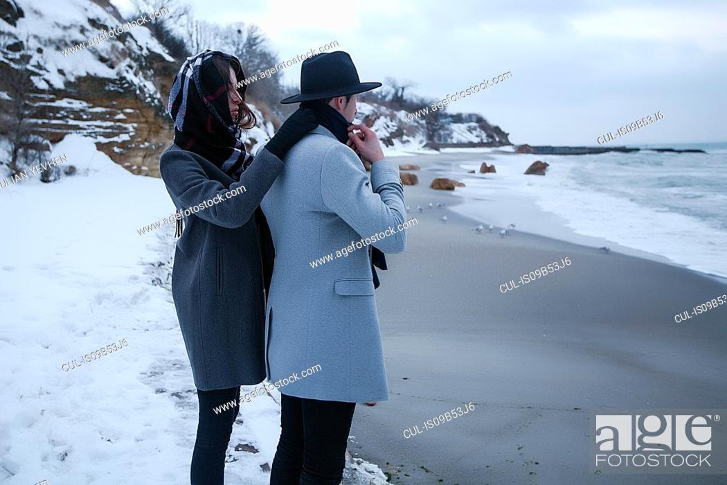 Stock Photo: Couple on winter vacation, Odessa, Ukraine.