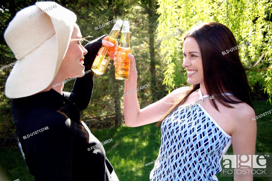 Stock Photo: Two women drinking beer.