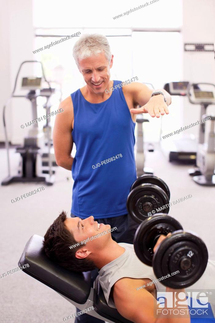 Stock Photo: Men working out in gymnasium.