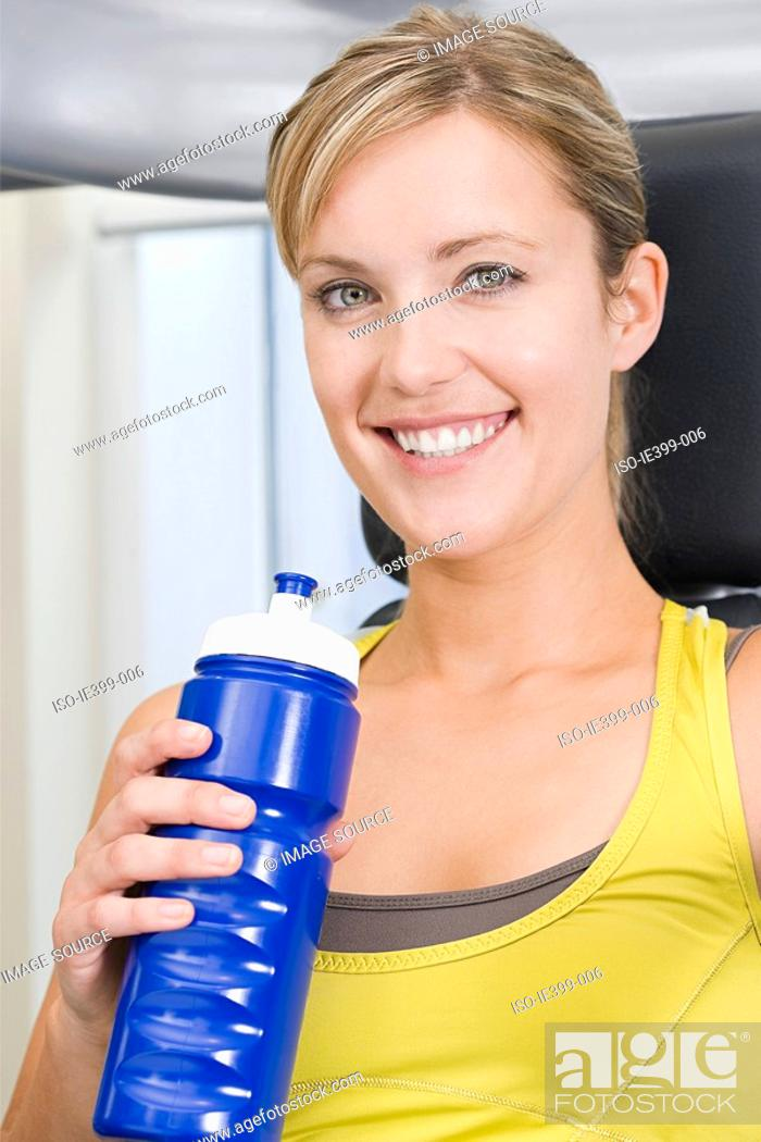 Stock Photo: Woman with water bottle.