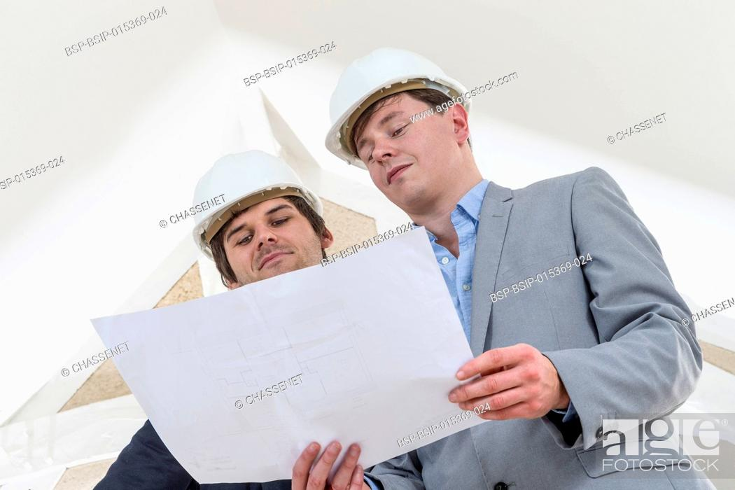 Stock Photo: Two Engineer or Architect discuss on Project at Construction site in white environment.