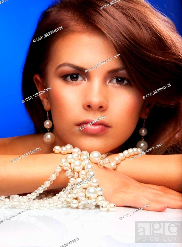 Stock Photo: Young woman with pearls.