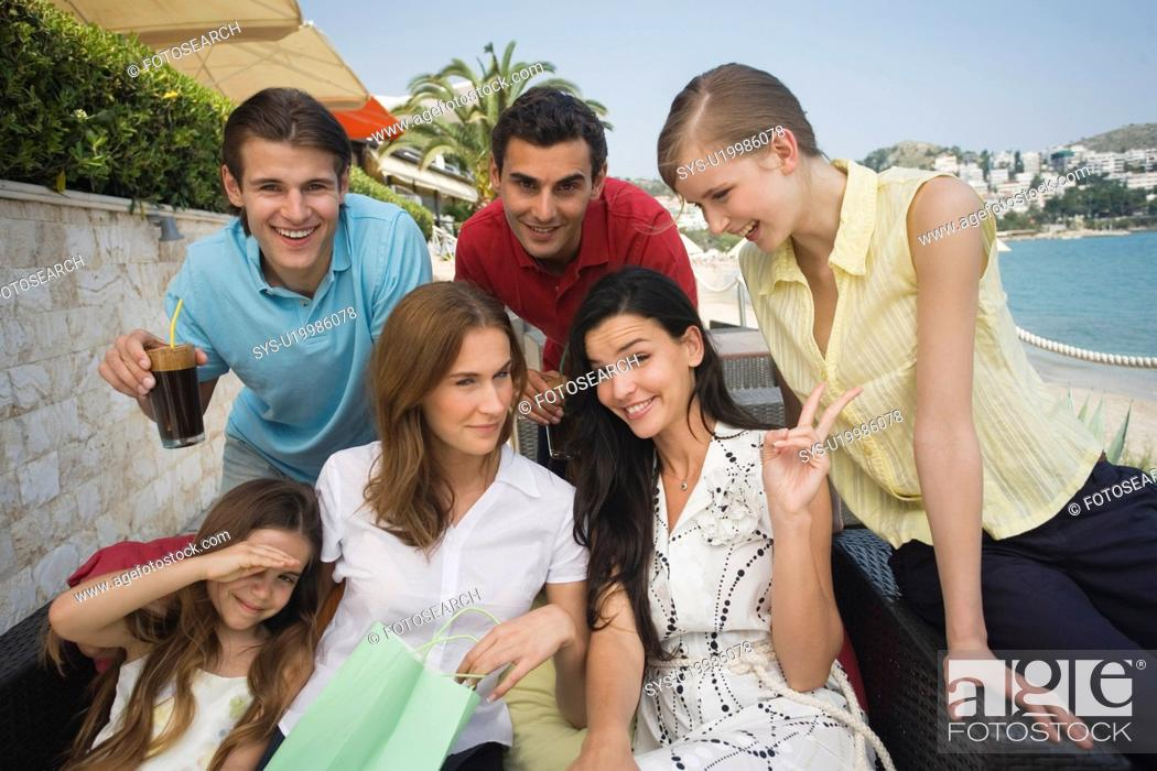 Stock Photo: Group of friends with shopping bags posing.