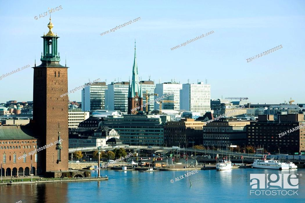 Stock Photo: Sweden, Stockholm, Kungsholmen Island, view of waterfront and town hall.