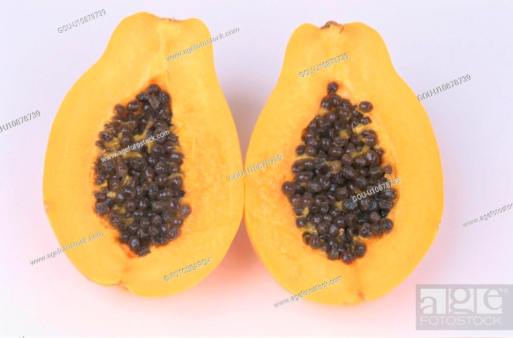 Stock Photo: Halved Papaya.