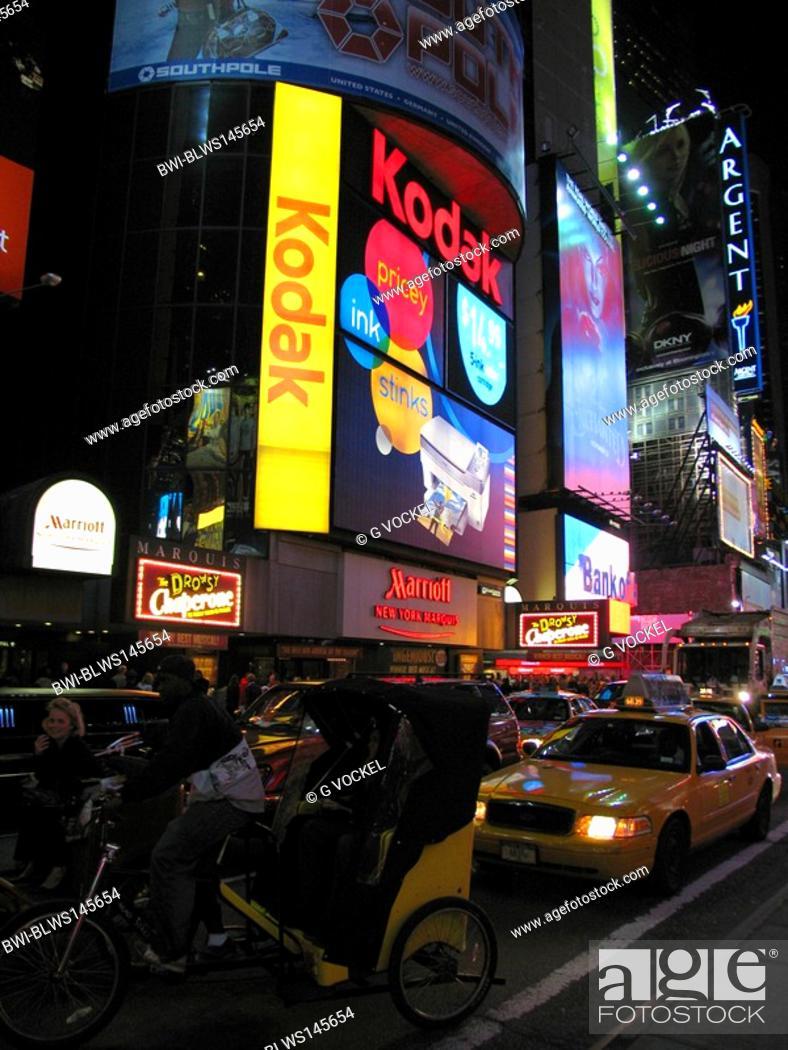 Time Square at night - Kodak Store, bicycle riksha and taxi