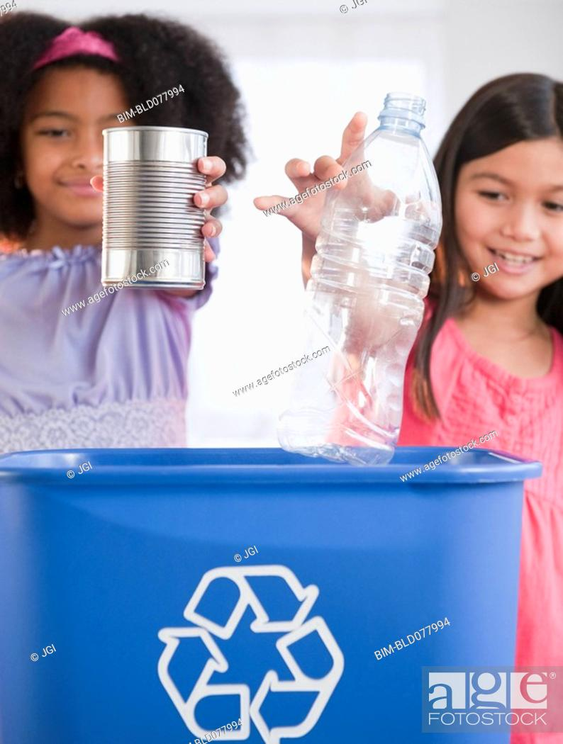 Stock Photo: Girls recycling can and bottle.