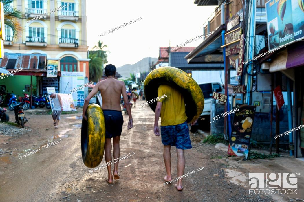 Stock Photo: Asia. South-East Asia. Laos. Province of Vang Vieng. Vang Vieng. Tourists returning from a day of tubbing.