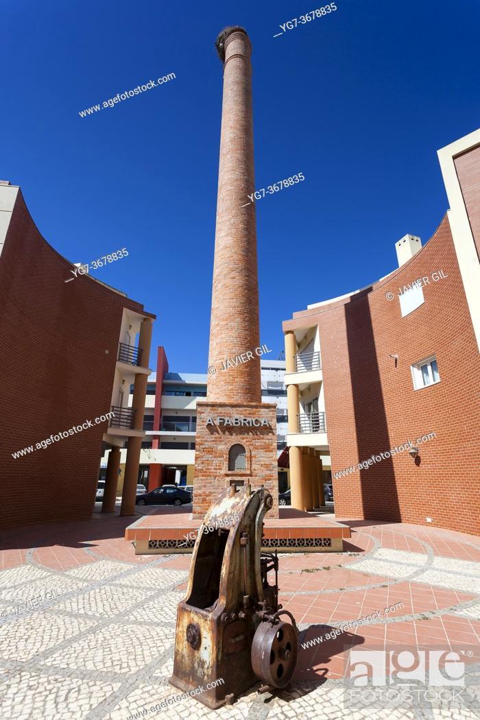 Stock Photo: Chimney of industry in Portimao, Algarve, Portugal.