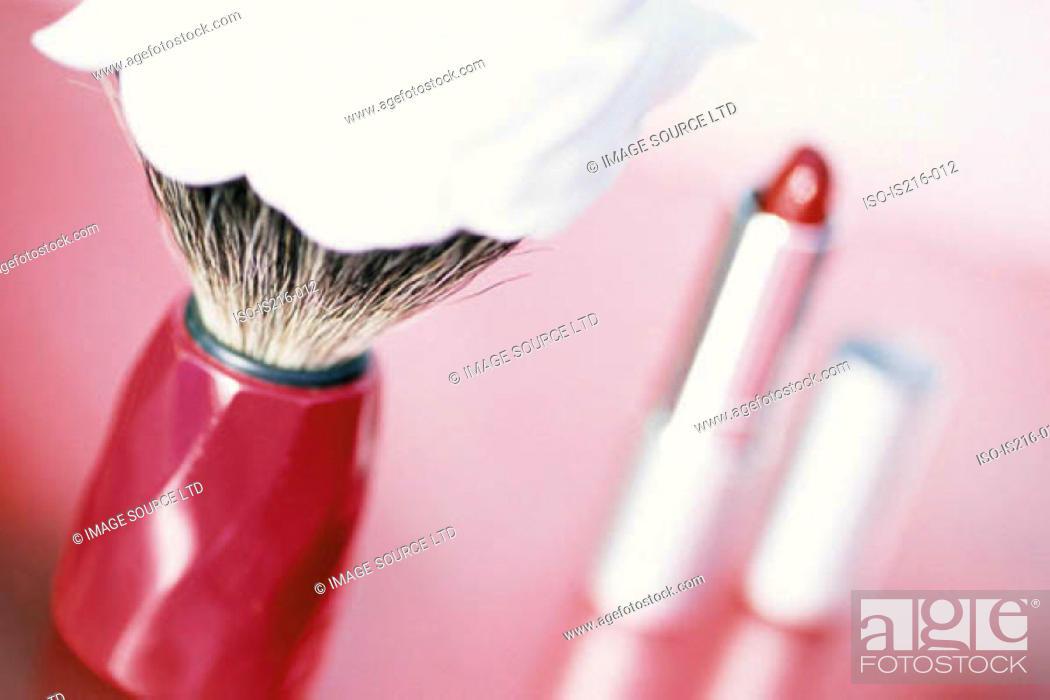 Stock Photo: Lipstick and shaving brush.