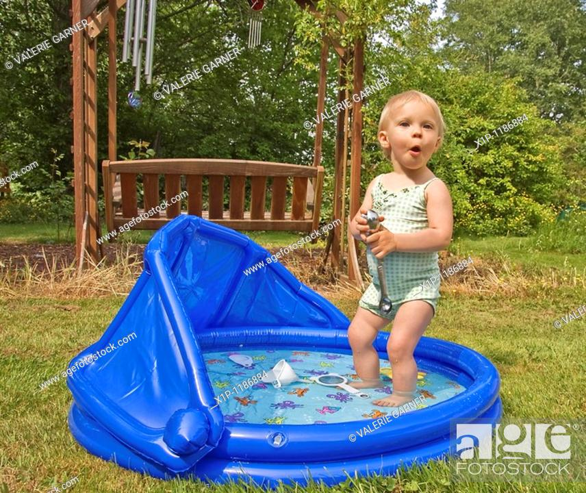 Stock Photo: Age eighteen months , Attractive , Backyard , Bathing suit , Blond hair , Blow up pool , Blue eyes , Blue pool , Caucasian , Child , Cooling off , Cute.