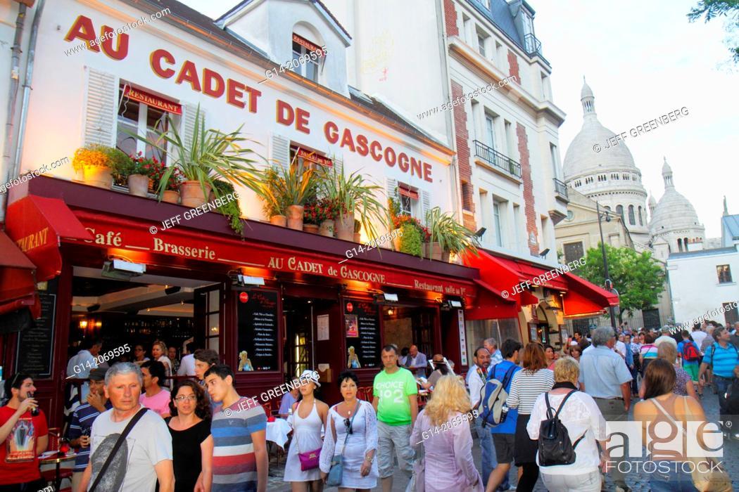 Stock Photo: France, Europe, French, Paris, 18th arrondissement, Montmatre, Rue Norvins, Place du Tertre, Au Cadet de Gascogne, restaurant, cafe, brasserie, tables, chairs.