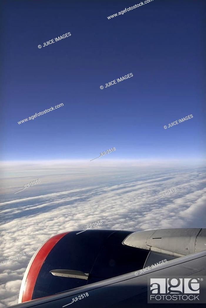 Stock Photo: Aerial view of sea, cloudscape and horizon from airplane.