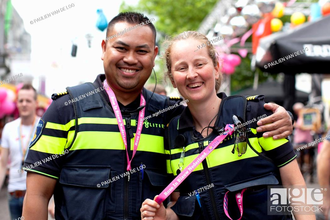 Stock Photo: Tilburg, Netherlands, Police officers are having fun during annual gay event in Tilburg.