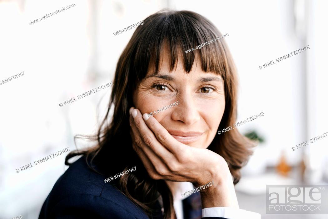 Stock Photo: Businesswoman in cafe, smiling.