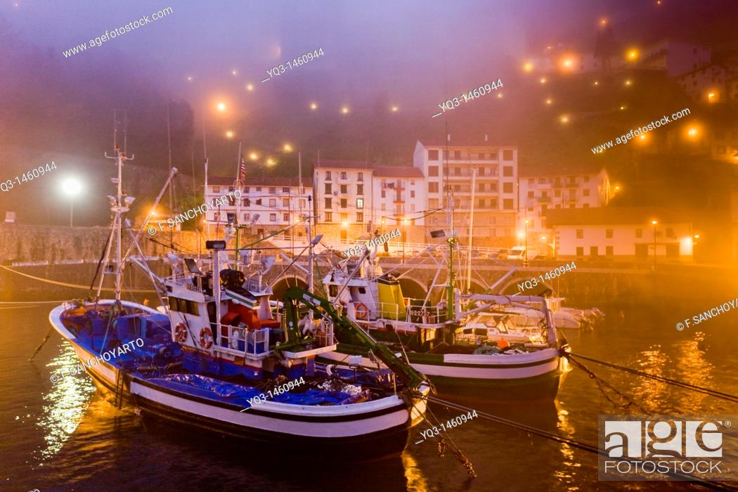 Stock Photo: Fishing boats in the mist at sunrise, port of Elantxobe, Urdaibai, Vizcaya, Basque Country, Spain.