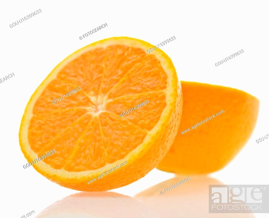 Stock Photo: Still life of halved orange against white background.