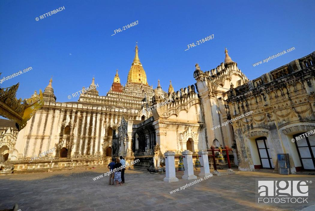 Stock Photo: Tourists in front of Buddhist temple, Ananda Temple, Bagan, Myanmar.
