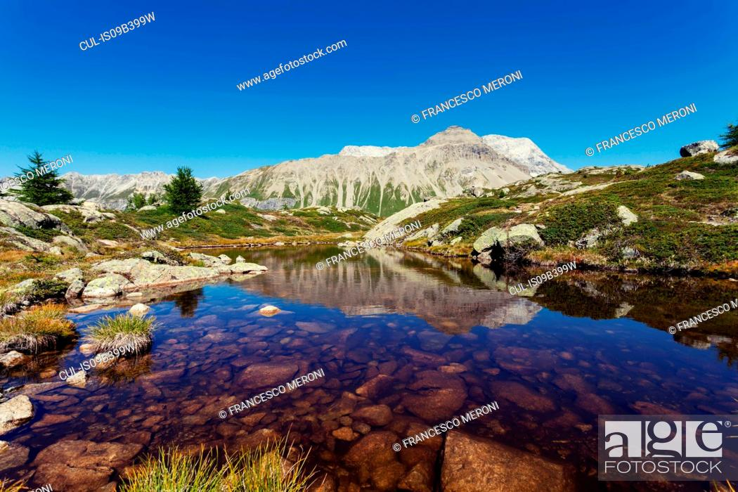 Stock Photo: View of lake and mountains, Albula Pass, Graubunden, Switzerland.