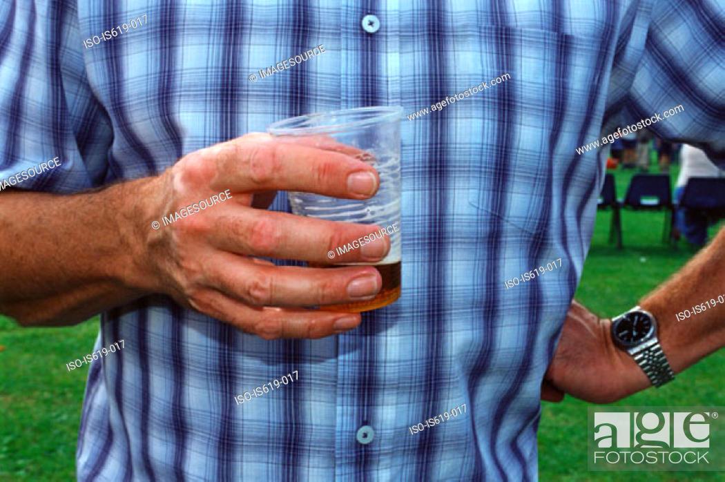 Stock Photo: Man drinking beer in garden.